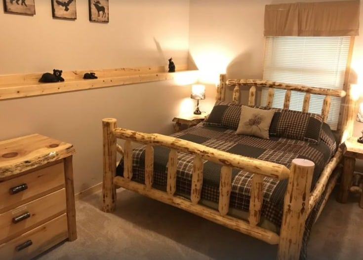 Best Winter Cabins in Wisconsin for Families, beautiful bedroom view of Hana Log Cabin near Devil's Lake- Baraboo