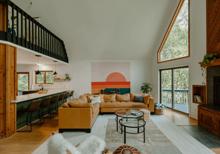 Best Airbnb in Wisconsin Dells near Christmas Mountain, Bright and funky open concept living room with stunning views of the bluffs in the distance.