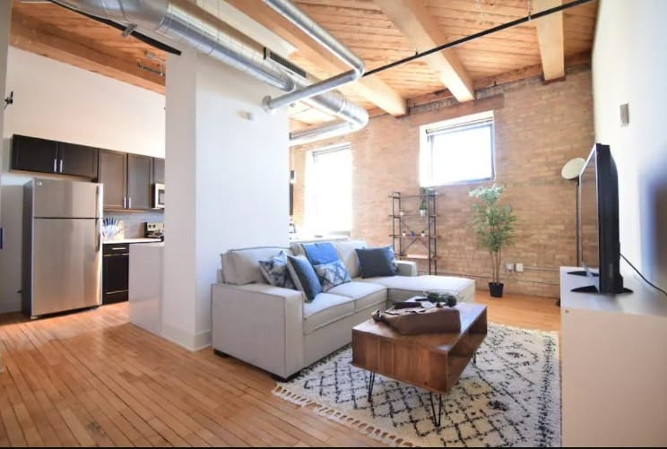 Best Milwaukee Rental for Couples, View of Livingroom in Industrial Loft with King Bed