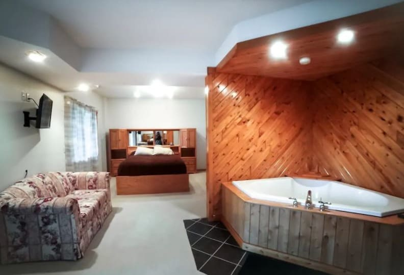 Best Cabin with Hot Tub in Northern Wisconsin, Bedroom view with hot tub in Lakefront Log Home (Mellen)