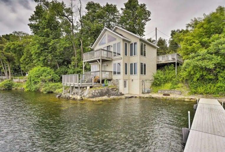 Best luxury cabin in door county, WI, lakefront view of luxury home w/dock, decks & grill