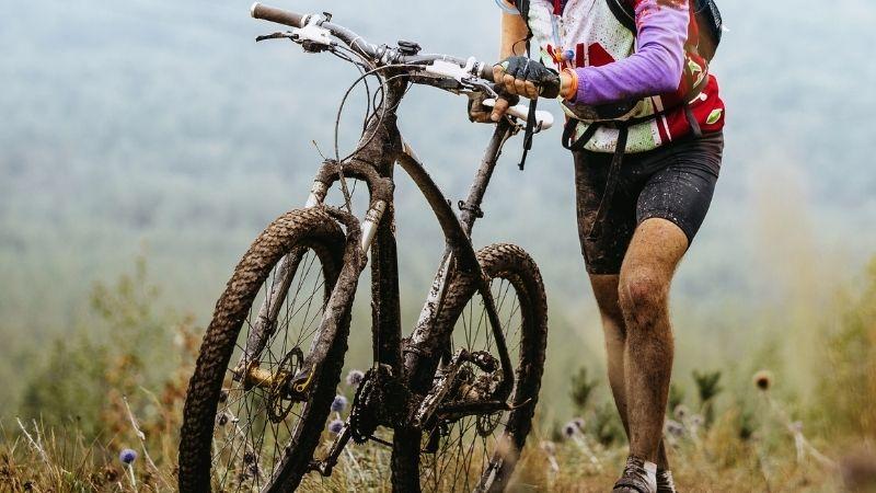 Best Wisconsin Mountain Bike Trails, A men Mountain Biking in a Hill