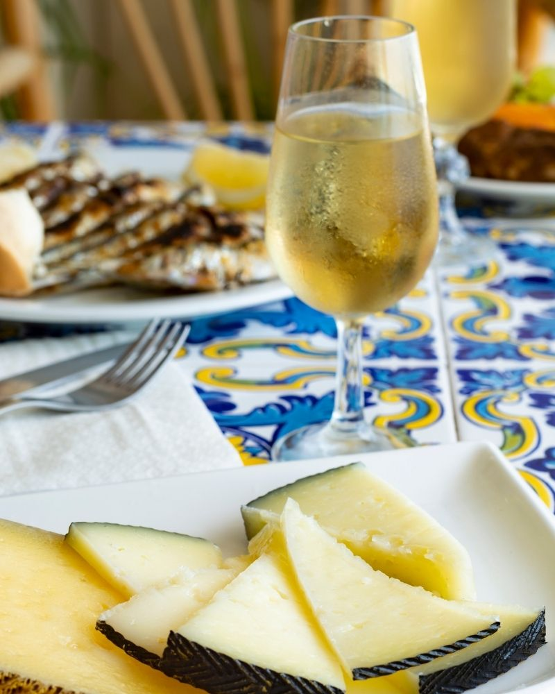 malaga wine with tapas cheese