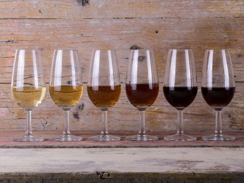 wineries in door county, row of different wines for tasting on wooden table
