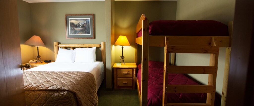 family vacation ideas wisconsin, hotel room with queen bed and bunk beds for kids at Cranberry County Lodge, Wisconsin