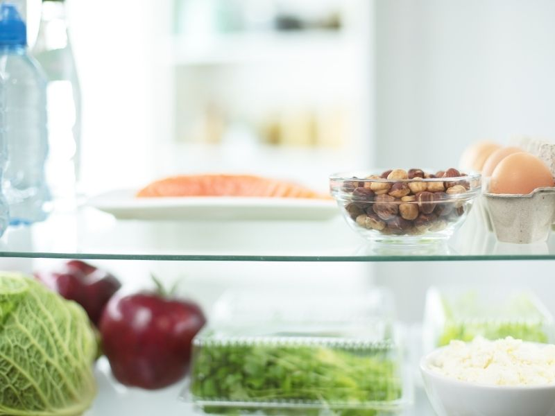 Open fridge full of fresh fruits and vegetables, healthy food background storing food