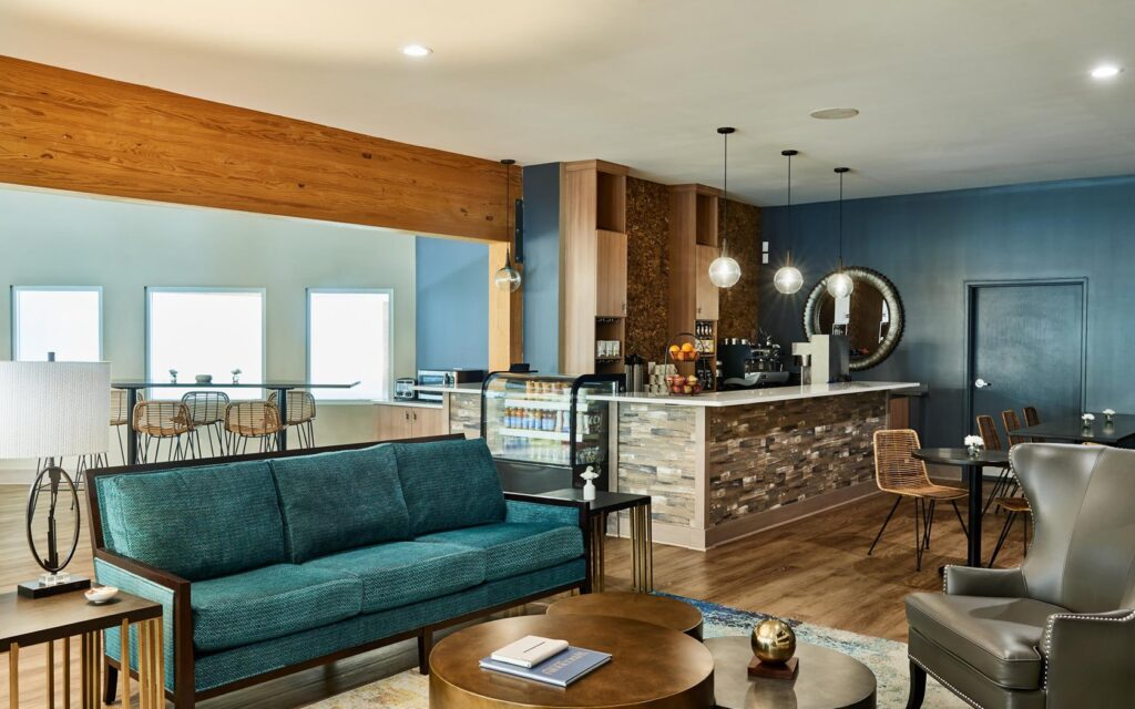 best family resorts wisconsin, large room with blue sofa and bar at the cove of lake geneva wisconsin