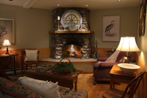 Best Door County places to stay, living room area with seating and a fireplace