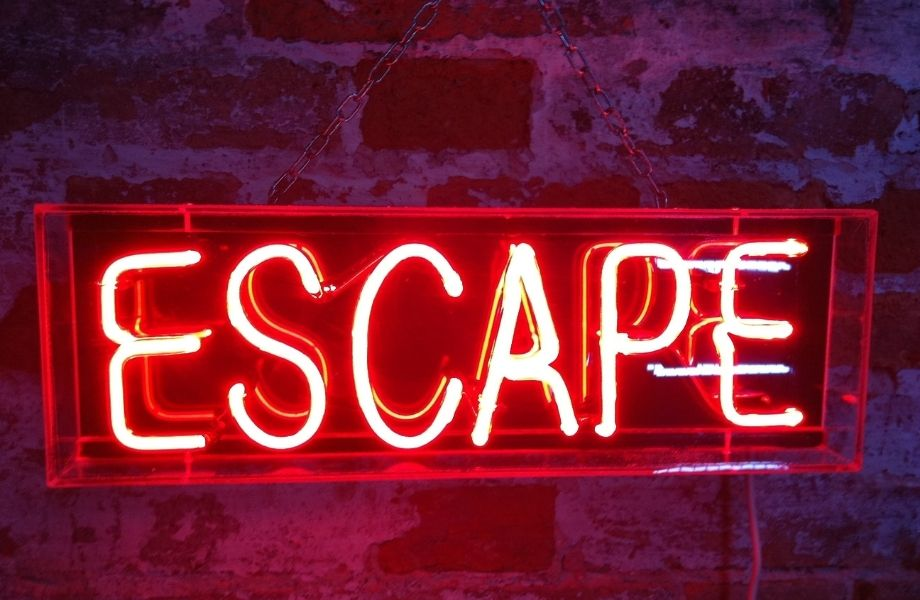 visit central wisconsin, neon sign reading ESCAPE