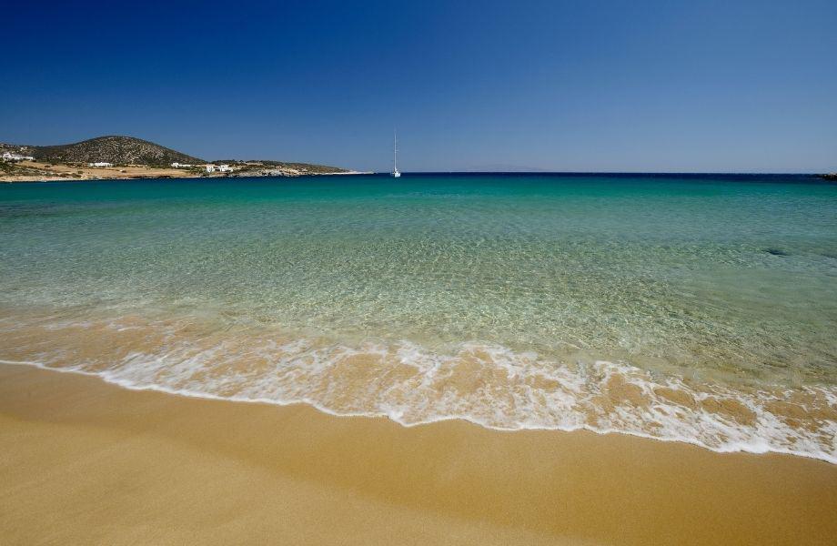 top beaches in Paros Greece, water covering the sandy beach along Faragas Beach Paros