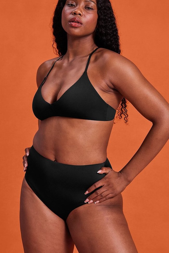 woman in black bikini from girlfriend collective; ethical swimwear brands for all sizes