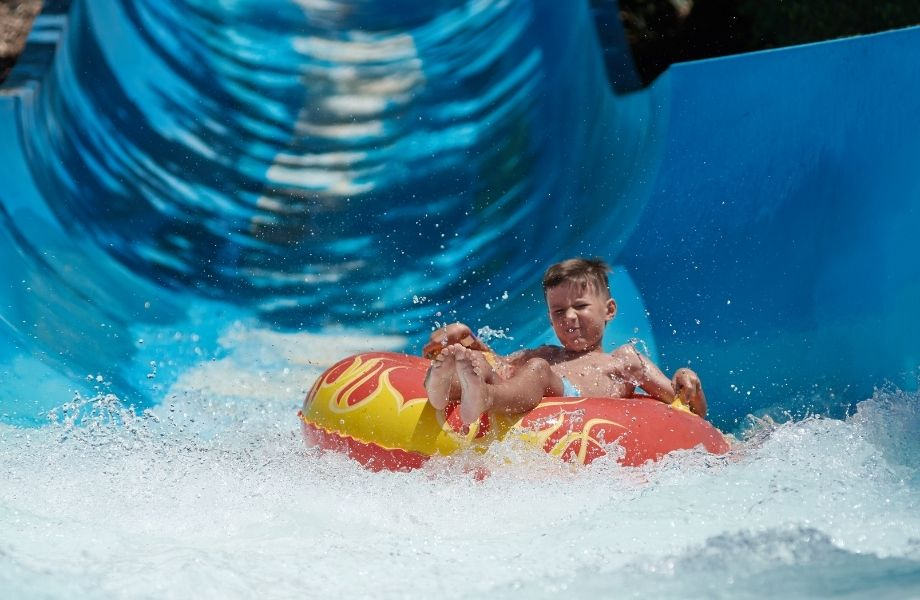 Wisconsin outdoor activities for the family, Kid tubing down a waterslide at waterpark
