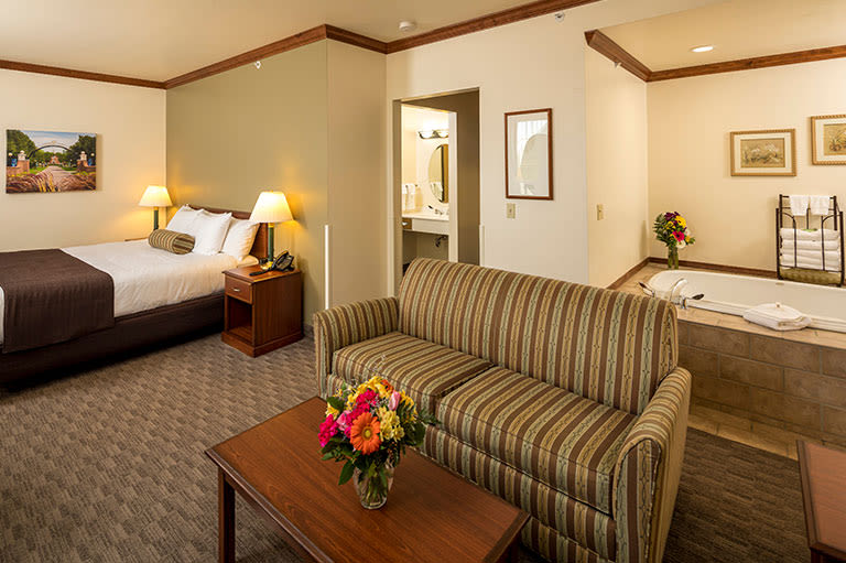 Best Door County hotels, room with bed, sofa and small coffee table