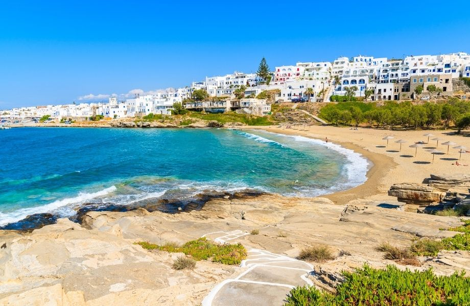 best beaches Paros has to offer this holiday season, Piperi Beach shoreline with white houses overlooking the coast