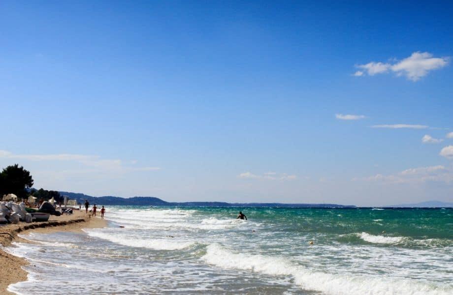 the top beaches in Paros, people walking along Punda Beach Paros