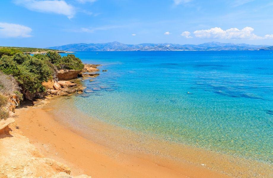Beautiful beaches in Paros Greece, see-through water at Santa Maria Beach Paros