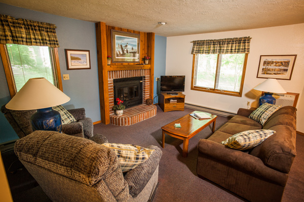 best places to stay in Door County with pets, suite living room with sofa, recliner, coffee table, tv and fireplace
