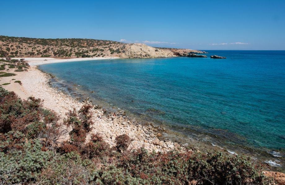 best beaches in Paros, Greece, curved shoreline of Tripiti Beach