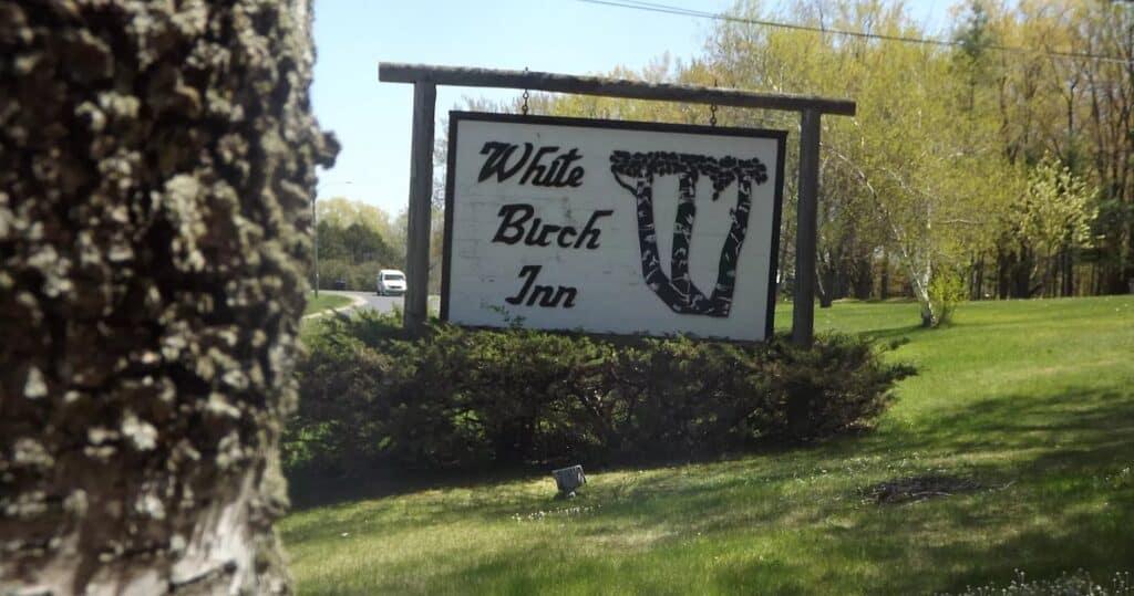 best pet-friendly resorts in Door County, hotel sign reading white birch inn
