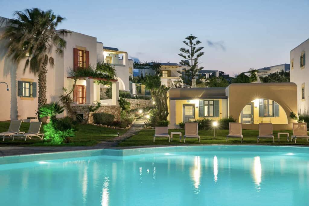 best hotels Greek Islands, exterior view of Acquamarina Resort lit up at night