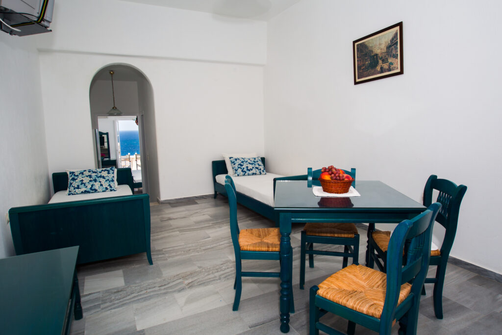 best places to stay in Paros, Arkas Inn room with two twin beds, table and four chairs, opens out onto beach