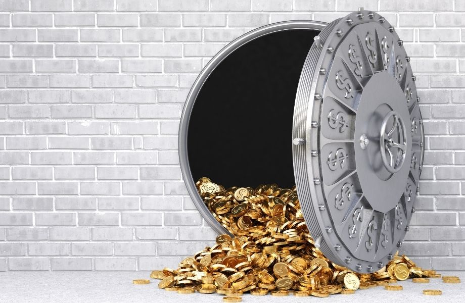 open safe with gold coins pouring out; the Eau Claire escape room has a bank vault themed room