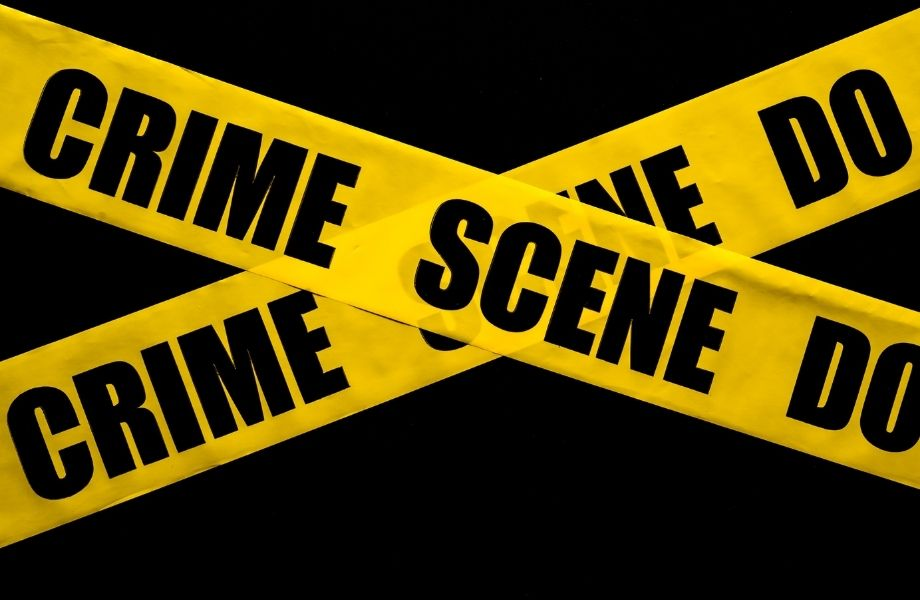 crime scene do not pass yellow tape; solve a cold case at the escape room in Oshkosh