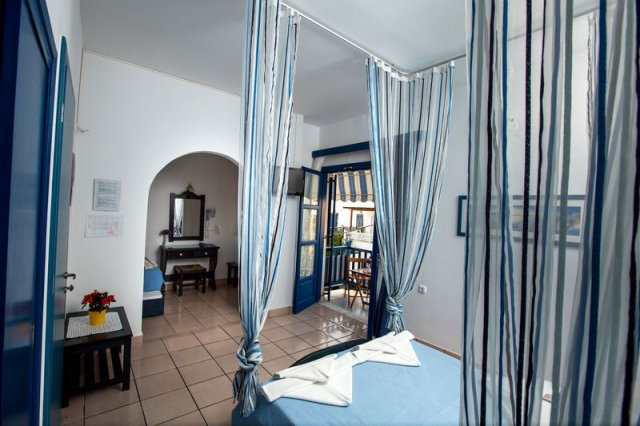 best hotels to stay at in Paros, canopy bed at Dilion Hotel