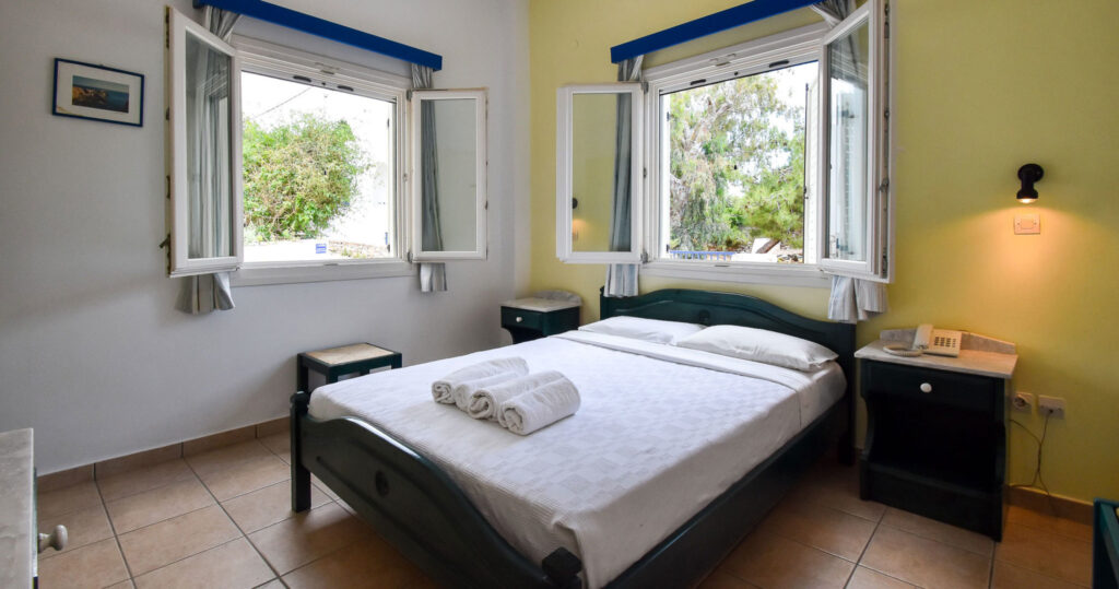 best budget accommodation in Paros, large double room with open windows at Hotel Ivi