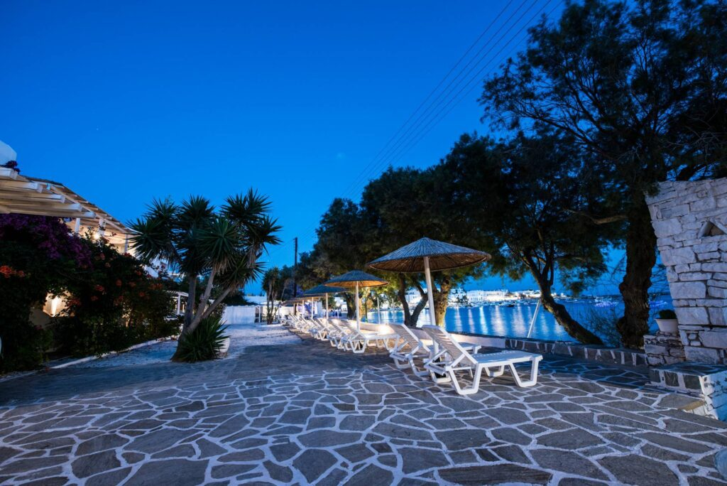 best accommodation for families in Paros, outdoor seating area overlooking marina at Ostria Studios & Apartments