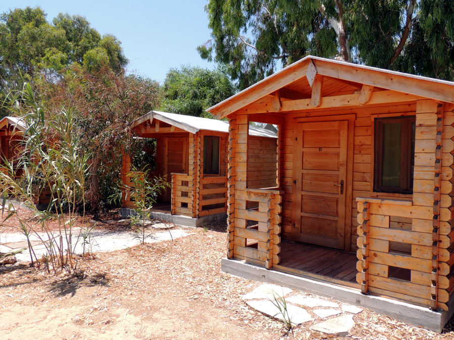 best budget hotels in Paros, wooden cabins at Surfing Beach Village Paros