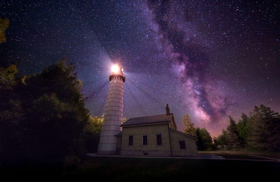 Beautiful lighthouses of Wisconsin, Cana Island Light Station shining at night
