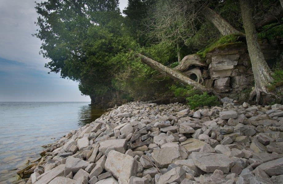 unique places to visit in Wisconsin, rocky coastline of Rock Island Wisconsin
