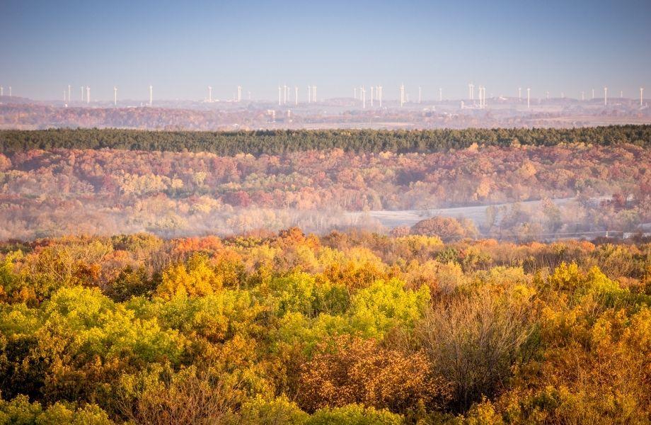 fall colors in northern wisconsin, miles of fall foliage with a city in background