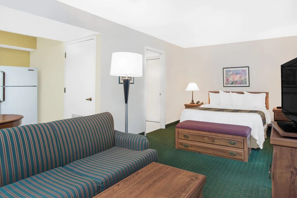 places to stay in green bay, large room with sofa, queen bed and kitchen at Hawthorn Suites Green Bay