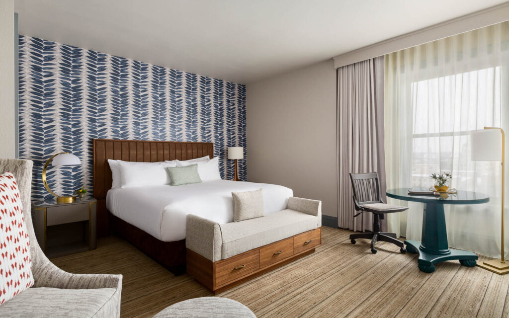 luxury hotels in green bay, room with table, comfy chair and bed at Hotel Northland