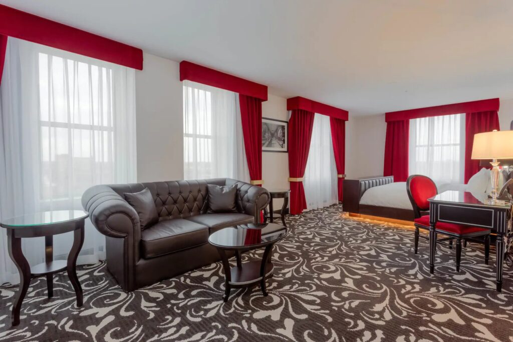 spa getaways Wisconsin, large room with bed, desk and seating area at Hotel Retlaw