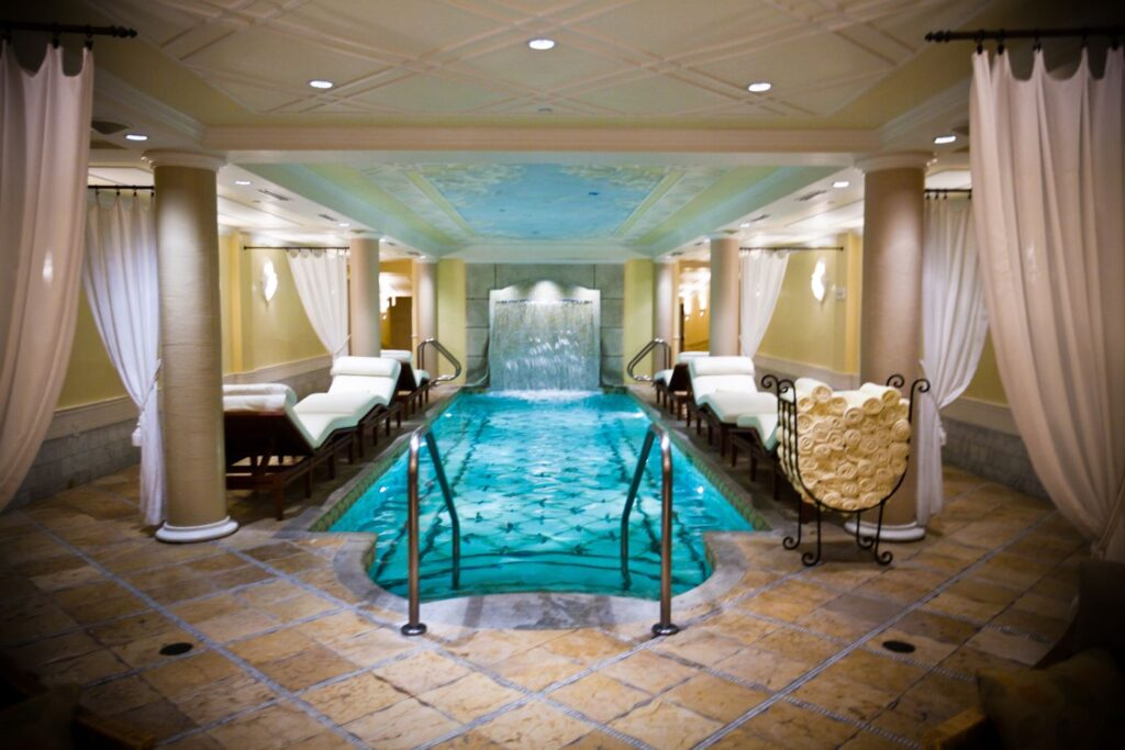 spa breaks for couples, pool spa area with chair beds at Kohler Waters Spa