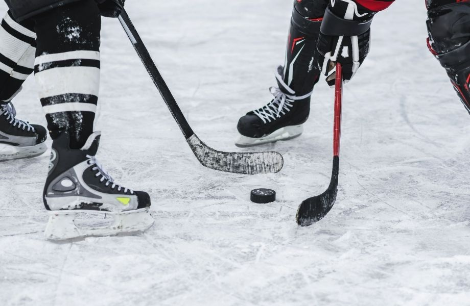 Door County winter guide, two people playing hockey