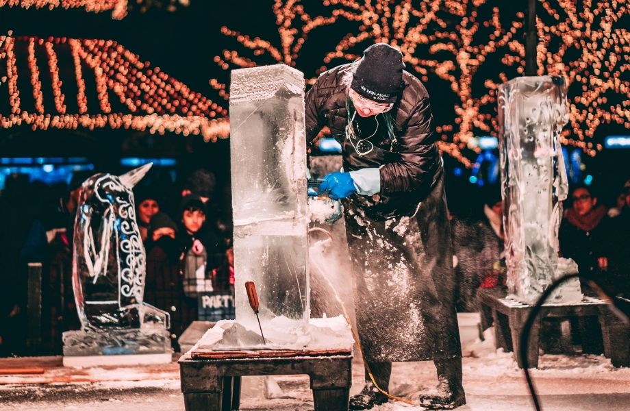 winter festivals in wisconsin, man carving ice