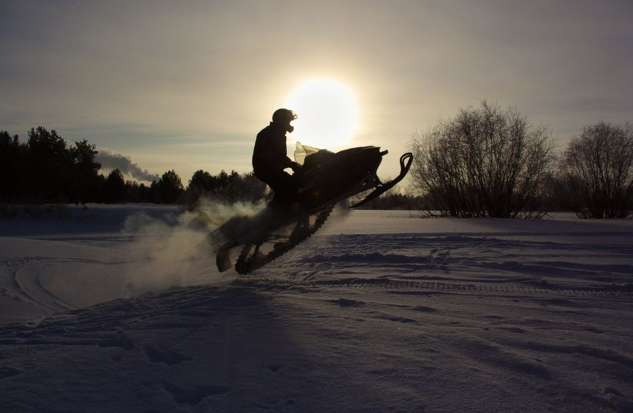 shawano county snowmobile trails, person riding a snowmobile at dusk
