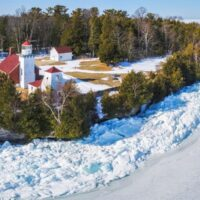 best places to visit Door County in winter, Sherwood Point Lighthouse surrounded by frozen lake