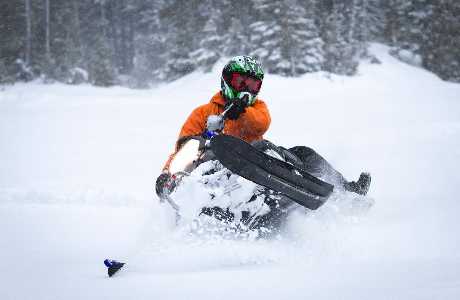 what to do in Door County in the winter, person riding snowmobile