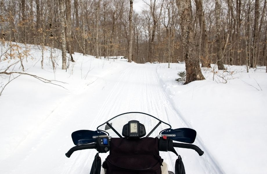 Boulder Junction Trails for snowmobiling, looking out a trail over a snowmobile
