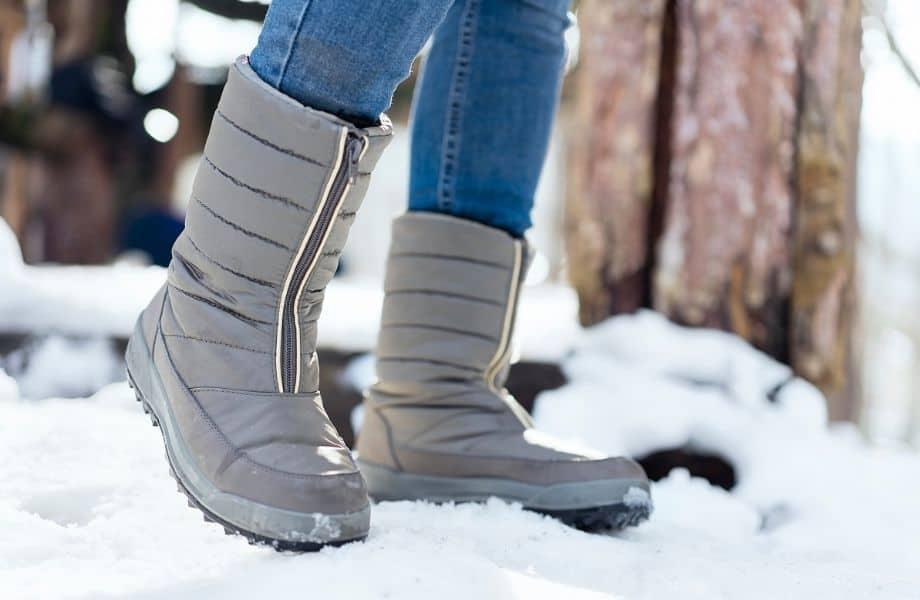best vegan winter boot brands, warm grey boots in the snow