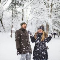 best men and womens vegan winter coats, man and woman out in the snow
